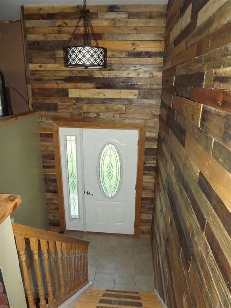 my foyer my bi level home foyer with pallet wood walls for the
