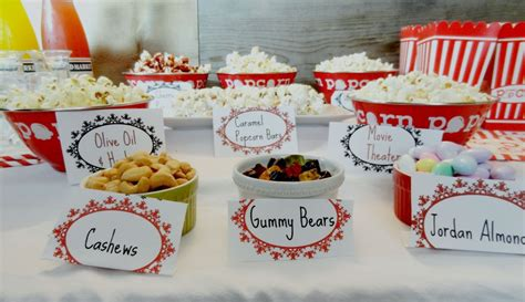 popcorn bar toppings diy family movie night ideas for summer simply southern mom