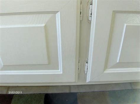 White Kitchen Cabinet Hinges | diy painter uses new rustoleum cabinet transformations on