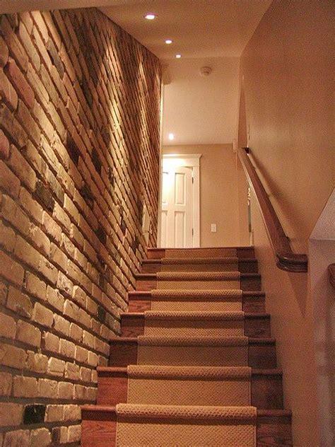 exposed brick wall lighting up basement stairs after basement stair basements