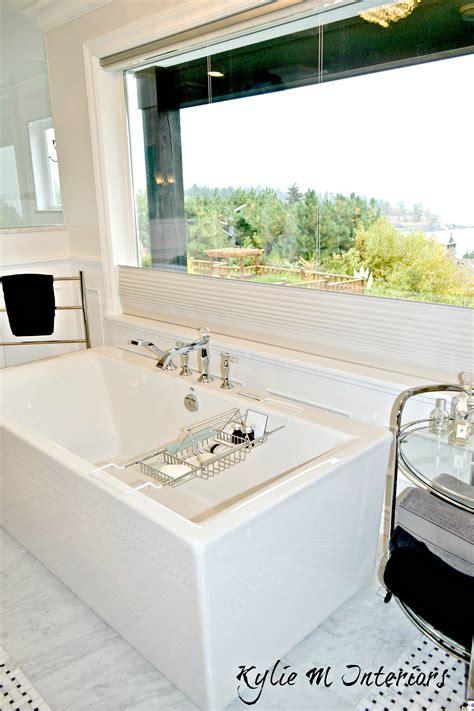 standing bath tub  marble tile surround