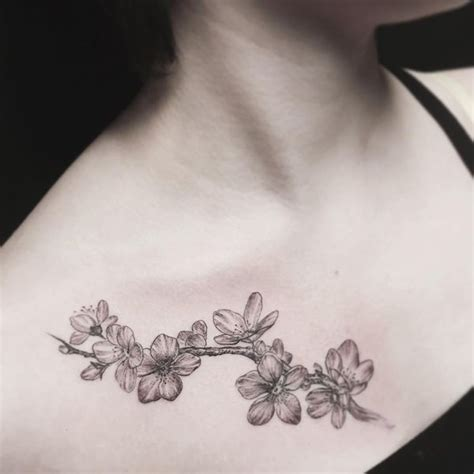 vine tattoo on chest 55 cherry blossom tattoo designs with meaning