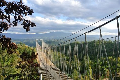 swinging bridge pigeon forge legacy mountain announces grand opening with longest