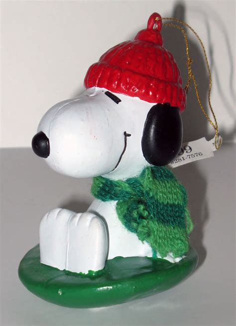 snoopy on sled christmas ornament collectpeanuts com