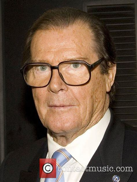 roger moore roger moore signs copies of his book roger moore my