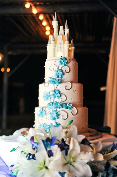 3 tier wedding cake disney inspired with fondant blue floral accent topped with a disney