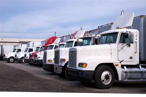 big rig semi trucks    models standing  row  stock photo image