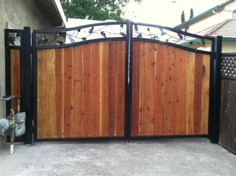 wrought iron wood combination drive way gate with handforged oak leaf vinework in top beautiful