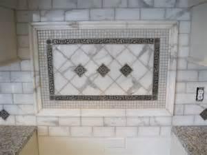 backsplash calacatta marble and antique pewter