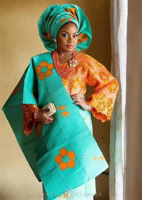 aso oke and lace attires for yoruba traditional weddings orange lace buba with orange green aso oke gele ipele and