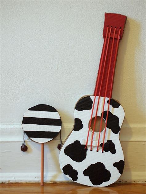 How To Make A Musical Instrument Out Of Paper - make a cardboard guitar pink stripey socks