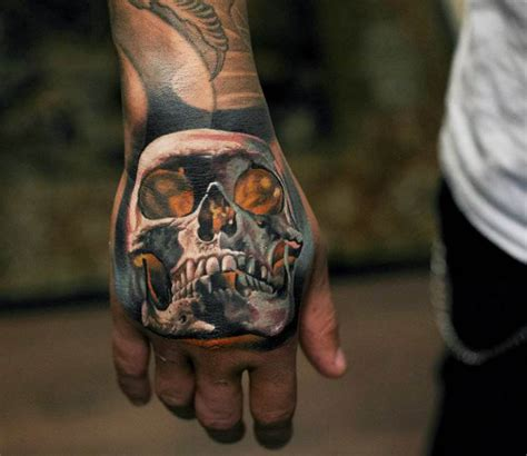 skull hand tattoo by denis sivak post 14411