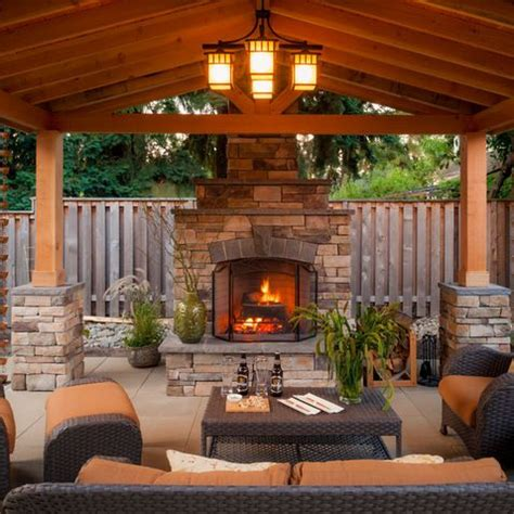 charm of an outdoor living space w grand fireplace paradise restored landscaping exterior