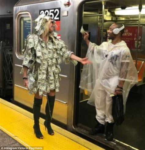 Money Dress model wears money dress in ny for the homeless