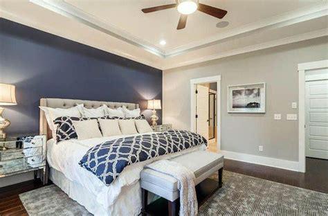 master bedroom  light gray walls  dark blue accent