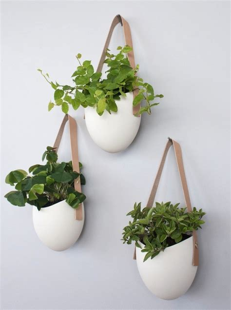 hanging planters set of 3 porcelain leather hanging planters gardenista
