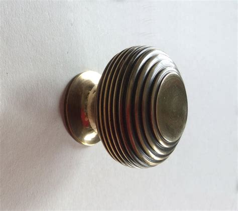 40mm Knobs by Beehive 40mm Cupboard Knob Aged Brass