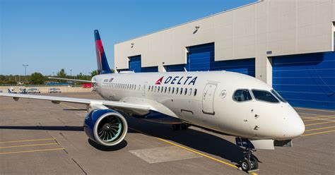 delta air lines airbus a220 cseries rolls out of paint shop
