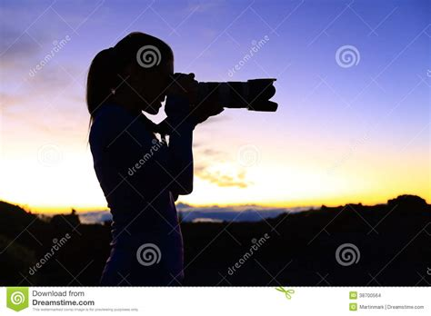 Taking A by Photographer Taking Pictures With Slr Stock Images