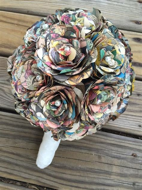 Wedding Bouquet Made From Books comic book bridal bouquet with white stem and white accent