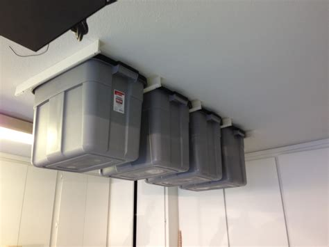 Garage Shelving That Hangs From The Ceiling Bin Tracks Allow You To Hang Storage Totes From Garage Or