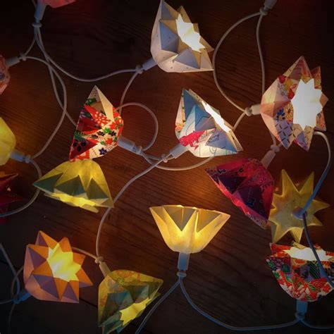 christmas lights journal star origami lanterns on a string of lights one of the gifts i made this year this
