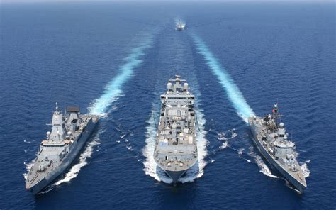 Vessel warships formation blue sea refueling marine