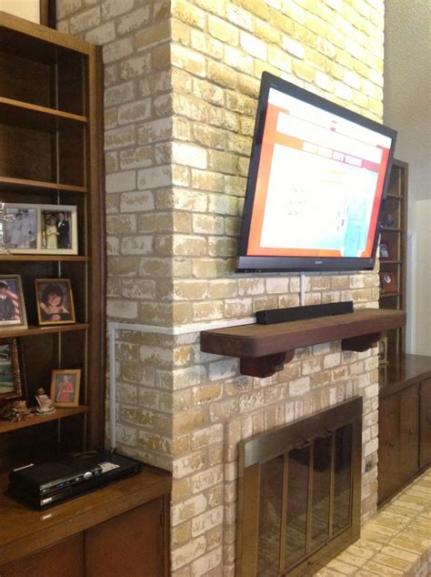 mount tv brick fireplace pin by janelle williams on home inspirations