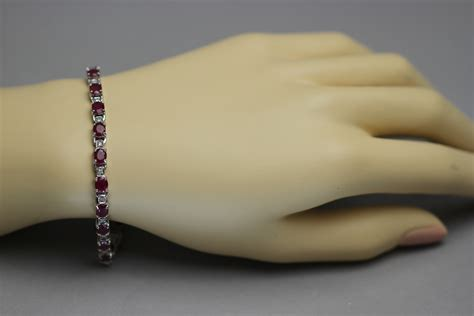 Ruby 8 65ct oval ruby and bracelet in 14k white gold 8 65ct