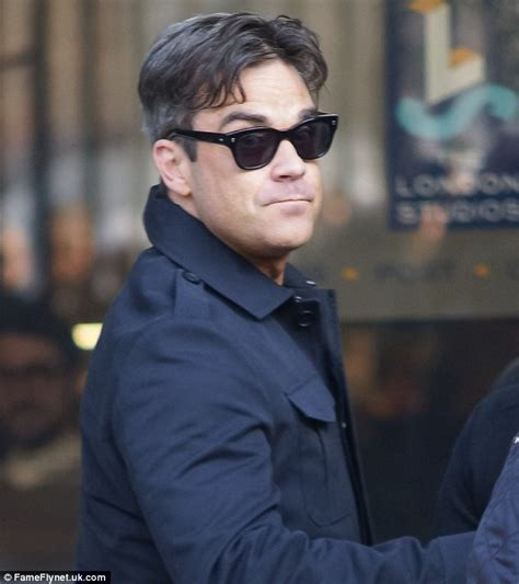 curtains hairstyle men robbie williams rolls back the years as he revisits his