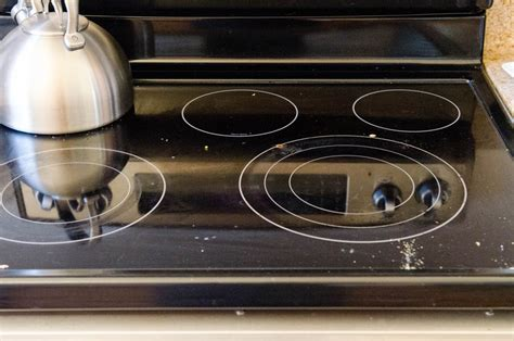 what can i use to clean grease off kitchen cabinets how to clean a glass electric stovetop kitchn