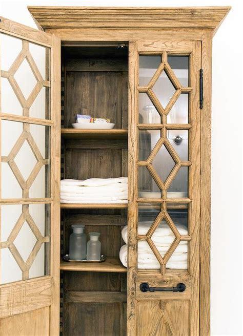 linen cabinet with glass doors georgian fretwork glass double door cabinet