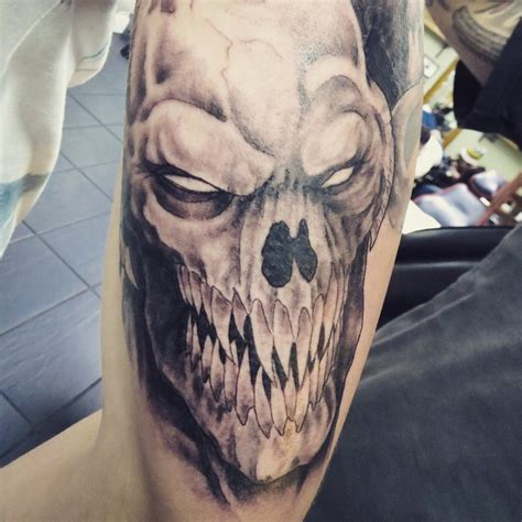 demon monster tattoo as part of tattoo sleeve by