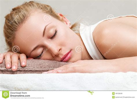 lying down in bed woman napping in bedroom stock photo image 49129240