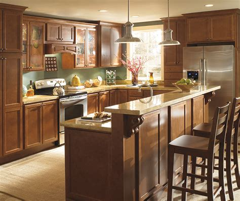 maple finish kitchen cabinets maple wood cabinets with white kitchen island homecrest