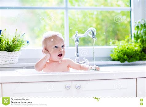 kitchen baby bath baby taking a bath in the royalty free stock image