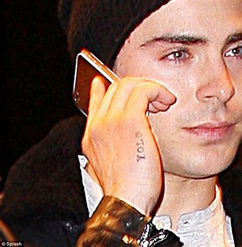 zac efron yolo tattoo rapper turns scrooge after demanding that retailers