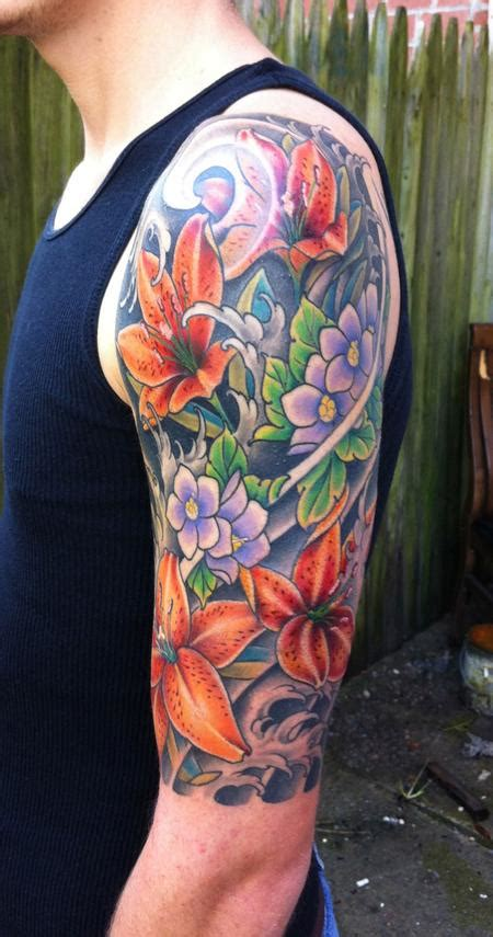 lily quarter sleeve tattoo off the map tattoo tattoos flower lily flower sleeve