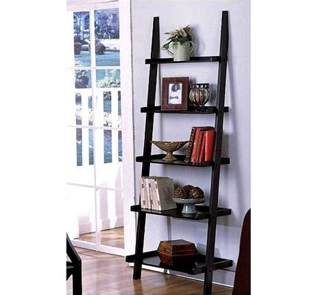 the leaning ladder style magazine and bookshelf by the