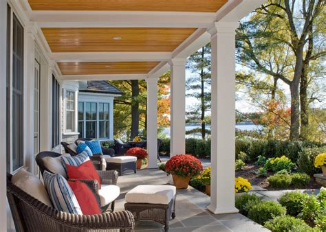 Beadboard porch ceiling porch traditional with patio chairs red pillows brown outdoor furniture