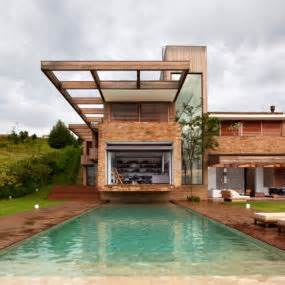 contemporary hillside home in brazil disappears into the landscape single storey house plans modern house m