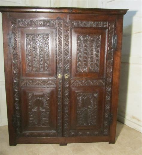 Carved Wardrobe by 17th Century Carved Oak Wardrobe Or Housekeepers Cupboard