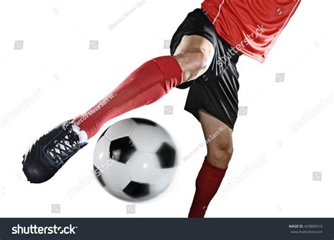 football kicking shoe up legs and soccer shoe of football player in