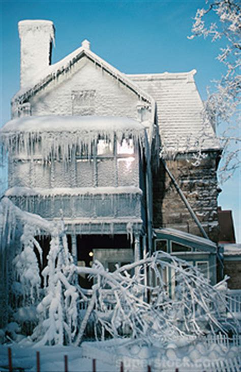 Frozen House by Water Damage From Freezing Weather Burst Pipes Or