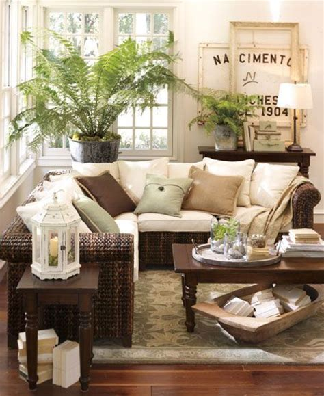 pottery barn decor ideas sun room full of books plants perfect furnishings for