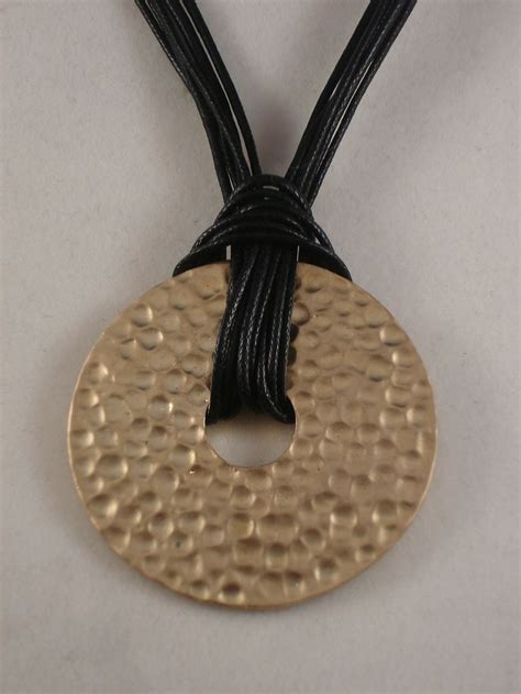 black cord necklace gold color 1 3 4 quot bent metal pendant