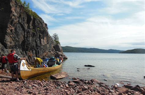 canoes in a fog lake superior paddle lake superior with the voyageur canoe musical tour