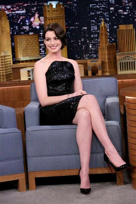 high heels show hathaway crossed legs in a black dress and