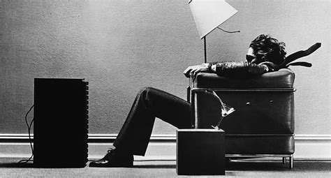 Sitting In Chair In Front Of Speaker by File Maxell Blown Away Jpg Uncyclopedia Fandom Powered