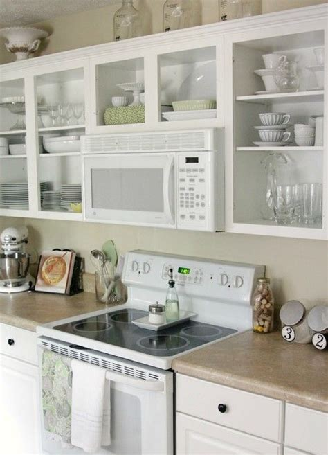 over the range microwave and open shelving kitchens